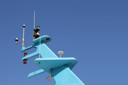 Ship antenna for navigation and communication on blue tower